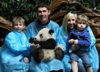 Tourists Hold Panda in Chengdu
