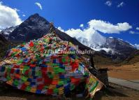 Prayer Flags and Snowclad Mountains