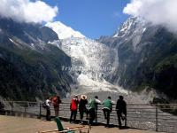 Tourists Watch the Glacier Fall in Hailuogou National Glacier Forest Park