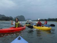 Tourists Enjoy Kayaking in Li River