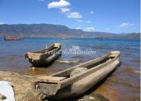 The pig-trough boats of Mosuo People in Lugu Lake