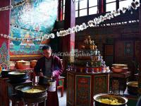 A Lama Prepares Food for Lunch in Shouling Temple