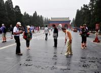 People Are Writing Water Calligraphy in Temple of Heaven