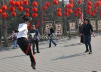 A Girl is Kicking Shuttlecock in Temple of Heaven Park